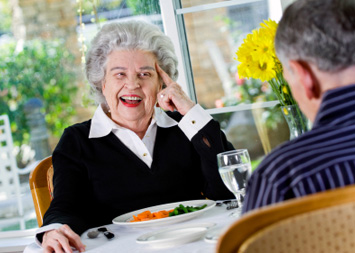 photo of elderly couple enjoying lunch